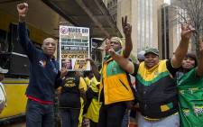A group of ANC members gathered outside Luthuli House in Johannesburg's CBD in a show of solidarity with President Jacob Zuma as marches against the president take place across the country on 7 April 2017. Picture: Reinart Toerien/EWN.
