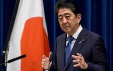 FILE: Japan's Prime Minister Shinzo Abe gestures as he answers questions during a press conference at his official residence in Tokyo on 25 September 2017. Picture: AFP.
