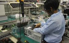 Computer assembler at the Mustek factory in Midrand. Picture: Taurai Maduna/EWN""