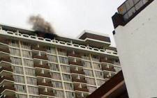 A fire broke out in a bedroom at the Mariston Hotel student accommodation building in the Johannesburg CBD on 13 November 2013. Picture: @MphazimaXaba/Twitter.