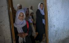 School girls gather at their class after arriving at a gender-segregated school in Kabul on 15 September 2021. Picture: AFP