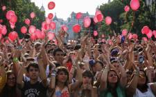 Hopeful crowds show support for Madrid's bid to host the 2020 Olympic Games at the Puerta de Alcala in Madrid on 7 September 2013. Picture: AFP/ PEDRO ARMESTRE