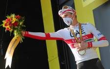 Stage winner Team UAE Emirates rider Slovenia's Tadej Pogacar celebrates on the podium after winning the 15th stage of the 107th edition of the Tour de France cycling race, 175 km between Lyon and Grand Colombier, on September 13, 2020. Picture: AFP