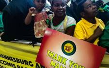 A mother and her daughter eagerly wait for the arrival of former AU head Nkosazana Dlamini-Zumba at OR Tambo international airport. Picture: Reinart Toerien/EWN.