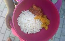 The food programme at Phakamisani Primary School includes rice, vegetables and pilchards. Photo: Siphokazi Mnyobe / GroundUp