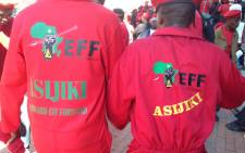 File: Economic Freedom Fighters showing off their party's message written on their uniform during their march to the Gauteng Provincial Legislature. Picture: Masego Rahlaga/EWN.