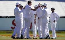 South African bowler Morne Morkel (3rd L) and his teammates celebrate the dismissal of West Indies batsman Devon Smith (not pictured) during the third day of the third and final Test cricket match between South Africa and the West Indies at Newlands cricket stadium in Cape Town on 4 January, 2015. Picture: AFP