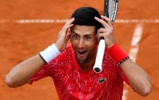 FILE:Djokovic twice recovered from a break down in the final set to seal a berth in the final four for the eighth straight year on his second match point. Picture: AFP