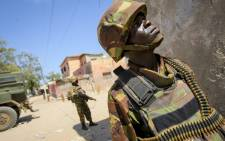 FILE: Kenyan soldiers of the AMISOM patrol the streets in the centre of Kismayo, a port city in southern Somalia. Picture: United Nations Photo.