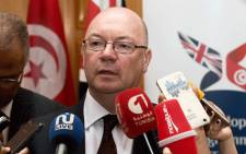 FILE: British minister of state for the Middle East and North Africa, Alistair Burt (L). Picture: AFP.