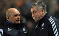 FILE: Former Chelsea's manager Carlo Ancelotti (R) and his former assistant Ray Wilkins arrive for their English Premier League football match against Hull City at The KC Stadium in Hull, northern England, on February 2, 2010. Picture: AFP.