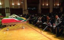 FILE: Nat Nakasa's coffin is draped in the South African flag on the day of his reburial, 13 September 2014 in Chesterville. Picture: Chanel September/EWN.