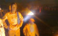 Inmates stand outside the Groenpunt Prison in Deneysville in the Free State after part of the facility was set on fire on 7 January, 2013. Picture: Supplied.