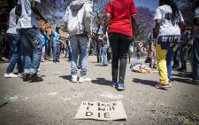 FILE: #FeesMustFall protesters sing and dance outside the University of Pretoria's Hatfield campus' during protests over tertiary education fees on 10 October 2016. Picture: Reinart Toerien/EWN.