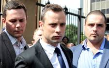 Oscar Pistorius leaving the High Court in Pretoria after day four of his trial on 6 March 2014. Picture: Sebabatso Mosamo/EWN.