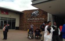 Shoppers waiting outside Maponya Mall in Pimville, Soweto, where an attempted armed robbery took place inside Pick n Pay on 17 December 2014. Picture: Masego Rahlaga/EWN.