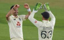 England's James Anderson celebrates the wicket of Pakistan's Azhar Ali with Jos Buttler on the first day of the second Test cricket match between England and Pakistan at the Ageas Bowl in Southampton, southwest England on 13 August 2020. Picture: AFP