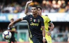 FILE: Juventus' Portuguese forward Cristiano Ronaldo controls the ball during the Italian Serie A football match AC Chievo vs Juventus at the Marcantonio-Bentegodi stadium in Verona on 18 August 2018. Picture: AFP.