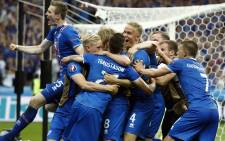 Iceland players celebrate their 2-1 win over Austria during the Euro 2016 group F football match between Iceland and Austria at the Stade de France stadium in Saint-Denis, near Paris on June 22, 2016. Picture: AFP
