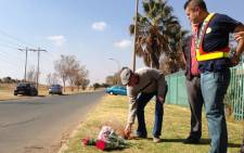 Flowers are placed at the scene of a shooting in Brackenhurst, south of Johannesburg where a father shot and killed his two teenage daughters.  Picture: Jacob Moshokoa/EWN.