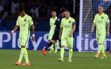 Vividly dejected FC Barcelona players walk to the dressing room after they suffered a 3-2 defeat to Paris St Germain in the Champions League on 30 September 2014. Picture: Facebook.com