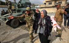 An Iraqi woman reacts as she flees Mosul's Jawasaq neighbourhood on 27 February, 2017, during an offensive by Iraqi forces to retake the area from Islamic State (IS) group fighters. Picture: AFP