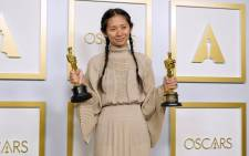 """Director/Producer Chloe Zhao, winner of Best Directing and Best Picture for """"Nomadland,"""" poses in the press room at the Oscars on Sunday, 25 April 2021, at Union Station in Los Angeles. Picture: Chris Pizzello-Pool/AFP"""