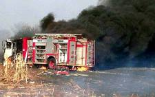 Three firefighters sustained serious burns and a fire engine was destroyed when it got caught alight in a runaway veld fire. Picture: Supplied.