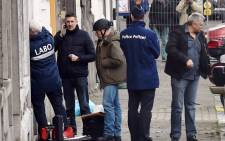 Members of the forensic team arrive at Colline street in Verviers, eastern Belgium, on 16 January, 2015, after police shot dead two suspects. Picture: AFP.