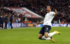 UNITED KINGDOM, London : England's Andros Townsend celebrates scoring his team's third goal during the World Cup 2014 Group H Qualifying football match between England and Montenegro at Wembley Stadium in north London on October 11, 2013. AFP PHOTO/ADRIAN DENNIS
