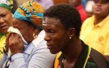FILE: Rethabile Mlotshwa sits inside Middelburg Magistrates Court during the appearance of the two men accused of racially abusing him after they attempted to lock him inside a coffin. Picture: Christa Eybers/EWN.
