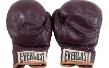 """Gloves worn by Muhammad Ali wore in the 1971 fight, against Joe Frazier, dubbed the """"Fight of the Century"""". Picture: @GoldinAuctions."""