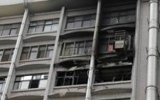 Burnt out windows are seen on a hospital following a fire on the seventh floor in New Taipei City on 13 August, 2018. Picture: AFP
