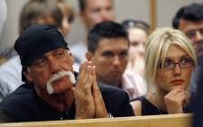A file picture showing Hulk Hogan and Brooke Hogan listening to testimony regarding charges against Nick Hogan during a court hearing. Picture: AFP.