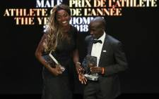 Colombia's athlete Caterine Ibarguen (L) and Kenyan athlete Eliud Kipchoge react after receiving the Male and Female athlete of the year award during the IAAF athlete of the year awards ceremony, on 4 December 2018 in Monaco.  AFP