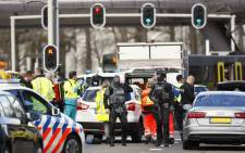 Police forces stand at the 24 Oktoberplace in Utrecht, on 18 March 2019 where a shooting took place. Picture: AFP