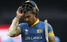 FILE: Sri Lanka's Danushka Gunathilaka walks back to the pavilion after losing his wicket for 76 runs during the ICC Champions Trophy match between India and Sri Lanka at The Oval in London on June 8, 2017. Picture: AFP.