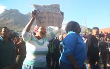 Imizamo Yethu residents protest outside the Hout Bay police station. As the winter cold sets in and living conditions in the structures become unbearable, residents want the city to move them onto land they can call their own. Picture:  Bertram Malgas