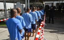 Inmates line up to receive doses of the Sinopharm COVID-19 coronavirus vaccine at Chonburi Central Prison in Thailand on 25 June 2021. Picture: Lillian SUWANRUMPHA/AFP