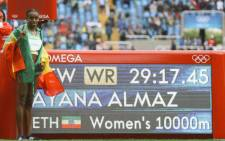 The day began in extraordinary fashion when Almaz Ayana smashed a 23-year-old world record to win the greatest-ever women's 10,000 metres. Picture: Twitter @Almaz_Ayana.