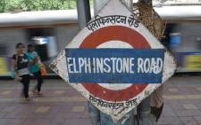 FILE: A local train departs from the suburbun Elphinstone railway station in Mumbai on 7 July 2017. Picture: AFP.