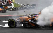 McLaren's Spanish driver Fernando Alonso's car is pictured after a crash during the first lap of the Belgian Formula One Grand Prix at the Spa-Francorchamps circuit. Picture: AFP