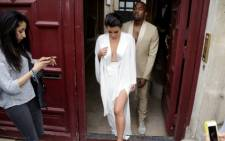 FILE:  US reality TV star Kim Kardashian (L) and American singer Kanye West (R). Picture: AFP.