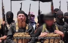A file image allegedly showing members of the Islamic state including military leader and Georgian native, Abu Omar al-Shishani (C-L) and ISIL sheikh Abu Mohammed al-Adnani (C-R), speaking at an unknown location between the Iraqi Nineveh province and the Syrian town of Al-Hasakah. Picture: AFP.