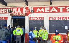 Members of the SAPS, Gauteng traffic police and the JMPD inspect a store in Soweto for compliance with lockdown regulations. Picture: @JoburgMPD/Twitter