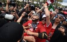 FILE: Anti-Trump protesters (L) clash with Donald Trump supporters (C) outside the Anaheim Convention Center during a rally for Republican presidential candidate Donald Trump on 25 May, 2016 in Anaheim, California. Picture: AFP.