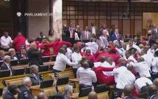 Members of the EFF being thrown out of the proceedings at the State of the Nation Address on Thursday, 9 February 2017. Picture: YouTube Screengrab.
