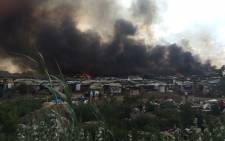 A fire rips through the Msawawa informal settlement in the Kya Sand area north-west of Johannesburg on 11 November 2015. Picture: IWN.