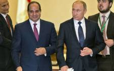 Russian President Vladimir Putin (C-R) arrives with his Egyptian counterpart Abdel Fattah al-Sisi (C-L) to give a press conference following their talks at the presidential palace in the capital Cairo on December 11, 2017. Picture: AFP.