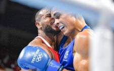 Moroccan heavyweight boxer Youness Baalla attempts to bite David Nyika's ear during his defeat to the New Zealander at the Tokyo Olympics. Picture: @PhotosportNZ/Twitter.
